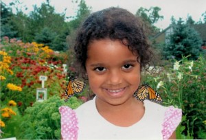 Child and monarch butterflies